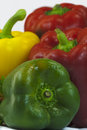Sweet peppers red yellow and green bell isolated on white Royalty Free Stock Photo
