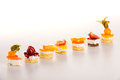 Sweet petite tarts fruit selection creamy desserts Royalty Free Stock Photo