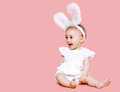 Sweet pink cute baby in costume easter bunny with fluffy ears Stock Photo