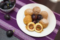 Sweet plum dumplings baker is poring powdered sugar over Royalty Free Stock Photography