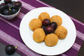 Sweet plum dumplings with fresh plums on white plate copy space composition Royalty Free Stock Images