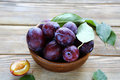 Sweet plums in a bowl fresh food Stock Image