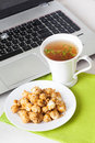 Sweet popcorn food on the table in still life tea party dessert computer, laptop, thyme Royalty Free Stock Photo