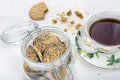 Sweet poppy seed shortbread biscuits with jam in a jar and cup of tea Stock Image