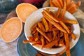 Sweet potato fries crispy golden displayed in country setting on turquoise enamelware Royalty Free Stock Images