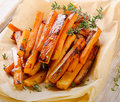 Sweet potato fries with  herbs . Royalty Free Stock Photo