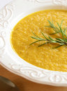 Sweet potato soup fresh homemade with sprig of rosemary Royalty Free Stock Photography