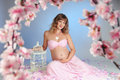 Sweet pregnancy beautiful pregnant woman surrounded by flowers Royalty Free Stock Images