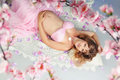 Sweet pregnancy beautiful pregnant woman surrounded by flowers Royalty Free Stock Image