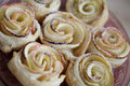 Sweet puff pastry roses with powdered sugar Royalty Free Stock Photos
