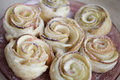 Sweet puff pastry roses with powdered sugar Stock Photo