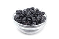 Sweet raisins in a glass on white background Royalty Free Stock Photos