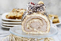 Sweet roll cake on transparent glass cake stand festive and party dessert Stock Image