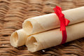 Sweet rolled wafers with red bow Stock Photography