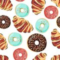 Sweet seamless pattern with croissant and donuts. Vector background for cafe, food design and packaging.