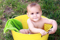 Sweet six month old baby in yellow bucket Stock Photos