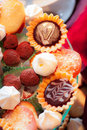Sweet small cakes closeup of Royalty Free Stock Photography