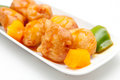 Sweet and sour chicken balls a traditional chinese take out food staple with green peppers orange sauce Royalty Free Stock Photo