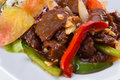 Sweet and sour fried beef served on white dish Royalty Free Stock Image