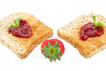 Sweet strawberries jam toast close up white background Royalty Free Stock Photos