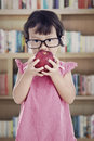 Sweet student in library Royalty Free Stock Photo