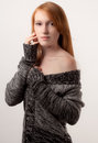 Sweet in a sweater portrait of pretty woman an off shoulder Stock Photo
