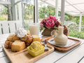 Sweet on table setting by window Royalty Free Stock Photo