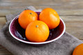 Sweet tangerines in a bowl on napkin Royalty Free Stock Images