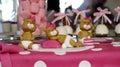 Sweet teddy bears on a pink birthday cake