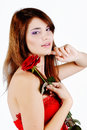 Sweet teen girl with rose over the white Stock Image