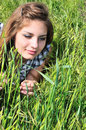 Sweet tender girl in grass Royalty Free Stock Images