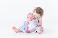 Sweet toddler girl kissing her newborn baby brother little Stock Photo