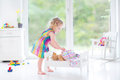 Sweet toddler girl playing with her teddy bear little Stock Image