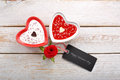Sweet treat for valentines day with card for text on white wooden background Royalty Free Stock Photo
