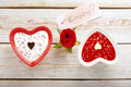 Sweet treat for valentines day with card for text on white wooden background Stock Image