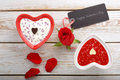 Sweet treat for valentines day with card for text on white wooden background Royalty Free Stock Photos