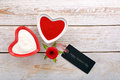 Sweet treat for valentines day with card for text on white wooden background Stock Photo