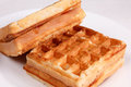 Sweet waffles in a white plate on a tablecloth Royalty Free Stock Photography