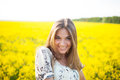 Sweet woman among yellow wildflowers in summer young Royalty Free Stock Photography