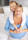 Sweet young girl and mother in a playful mood Royalty Free Stock Image