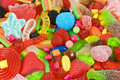 Sweetened assortment of multicolored candies Stock Photos
