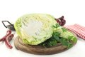 Sweetheart cabbage a sliced on a wooden board Royalty Free Stock Image