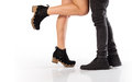 Sweethearts legs the of a couple of facing each other isolated in white Stock Images