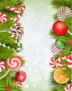 Sweets background with lollipop, candy, jelly beans, orange slice and pine tree Royalty Free Stock Photo