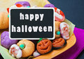 Sweets and candies for halloween and blackboard with congratulations Royalty Free Stock Images