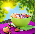 Sweets and candies for the holiday halloween on a background of leaves sky Stock Photo