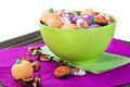 Sweets and candies for the holiday halloween lie on a wooden table Stock Photo