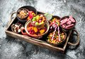sweets candy, candied fruits with marshmallow and jelly on a wooden tray. Royalty Free Stock Photo