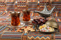 Sweets, dates and tea on a carpet