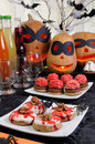 Sweets for halloween table served with a variety of and drinks on Royalty Free Stock Photos